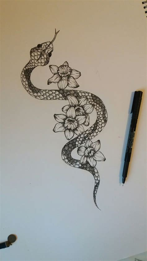 narcissus tattoo snake with narcissus flowers cool tattoos