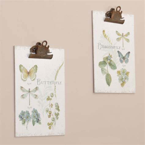and you brought a wall clip set of 3 the land of nod set of two wall mounted botanical butterfly clip boards by