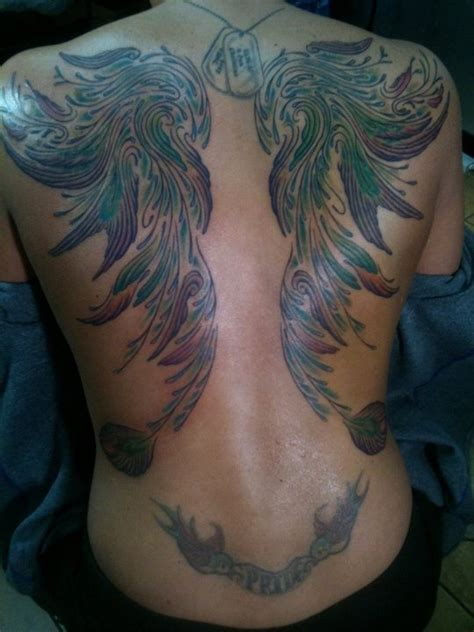 tattoo and piercing tag questions angel wings and dogs tags tattoo tattoos and piercings
