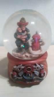 fireman child sankyo musical snow globe plays quot memory