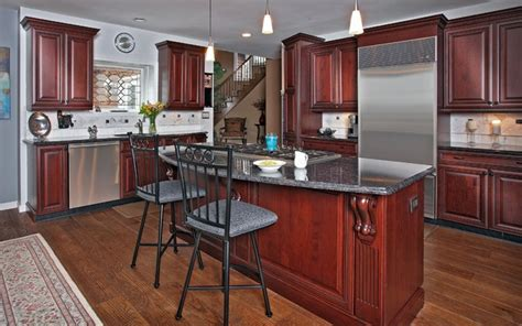 cherry cabinets with gray countertops dark cherry with gray accents traditional kitchen