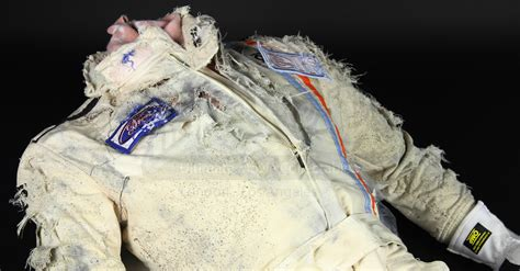 crashed racing driver body severed head in helmet rp235