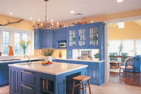 country blue kitchen cabinets blue and yellow kitchens white brown oak country