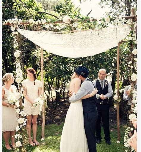 Wedding Arch Vs Chuppah by Chuppah Simple And Flower Petals On