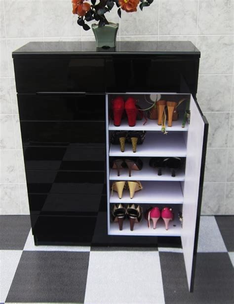 gloss black shoe cabinet with 2 doors and 2 drawers