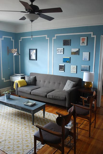blue walls grey couch ikea rug eclectic living room