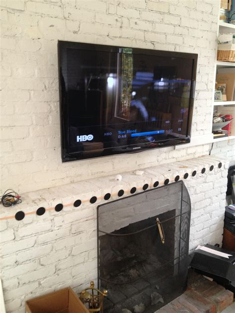 Mount Tv Above Fireplace Hide Wires by Tv Mounting A Brick Fireplace With Wires Concealed In