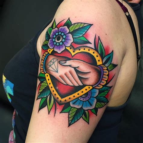 traditional heart and shaking hands tattoo by samuele briganti