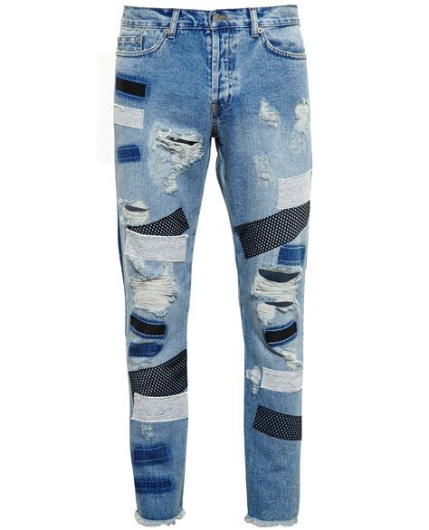 Patchwork Denim - distressed patchwork in blue for lyst