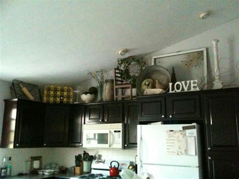 decorations for above kitchen cabinets the tricks you need to for decorating above cabinets
