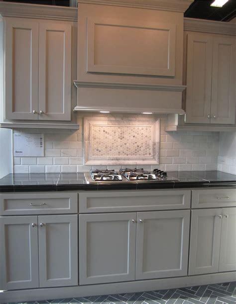 gray cabinets; black counters; slate herringbone floor