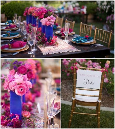 pink cobalt blue lesbian wedding table details cakes