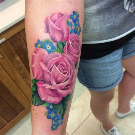 emma rose tattoo pink and blue flowers on forearm best
