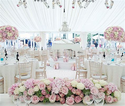 beautiful ivory and white wedding with pink flowers white