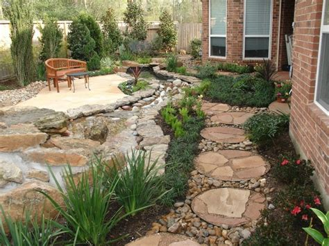 landscaping with oversize pavers and backyard creek hkns