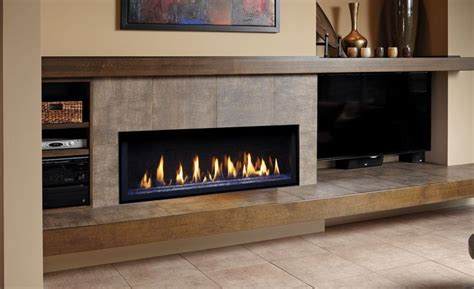linear fireplace with hearth and mantle tv on the