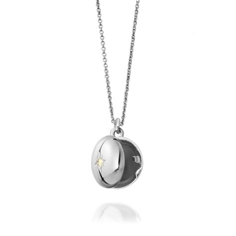 small locket in silver with moonstone by astley clarke at