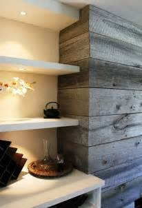 Very nicely done accent wall around a fireplace with beautiful grey