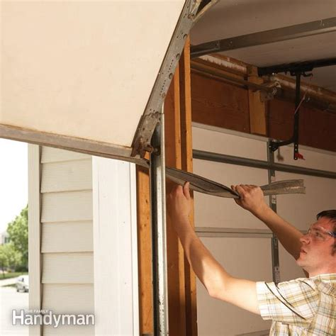 Replacing Wood Paneling by Fixing Garage Doors The Family Handyman