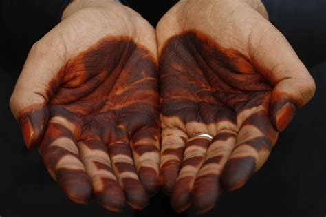 painted man hands  henna  weddings day sudan