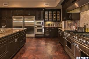 wide open kitchen with chocolate brown cabinets all
