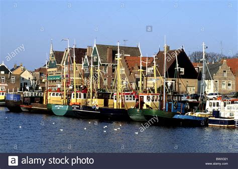 view fishing boats harbour port houses homes