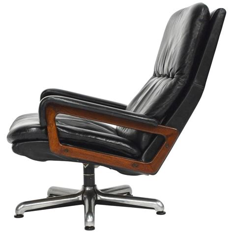 swivel cing chair strassle king swivel chair in black leather by andre