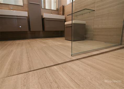 Curbless limestone shower   Céramiques Hugo Sanchez Inc