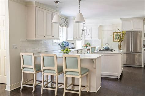 kitchen peninsula with blue leather counter stools and