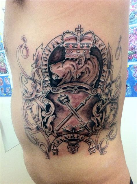 tattoo family on ribs family coat of arms tattoo on ribs for men tattoos book