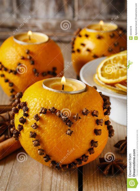 orange pomander ball  candle decorated  cloves