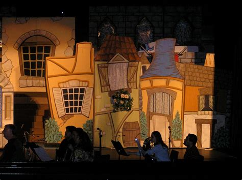 what town is beauty and the beast set in beauty the beast village right savard creative design