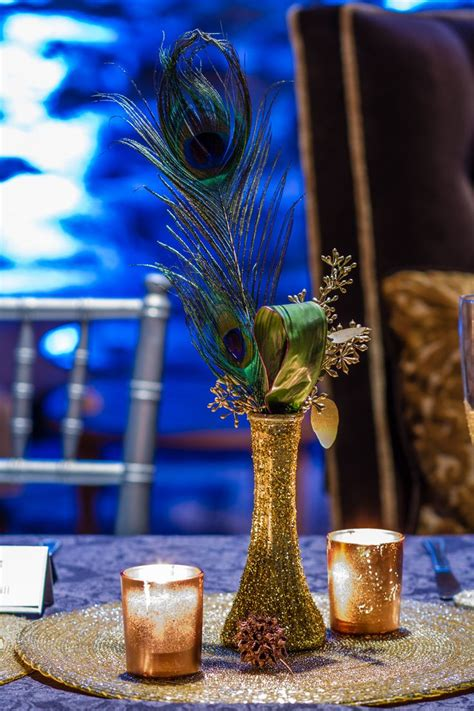 25 best ideas about peacock centerpieces on