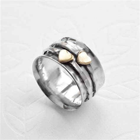 spun metal l sterling silver mixed metal spinning hearts ring by martha
