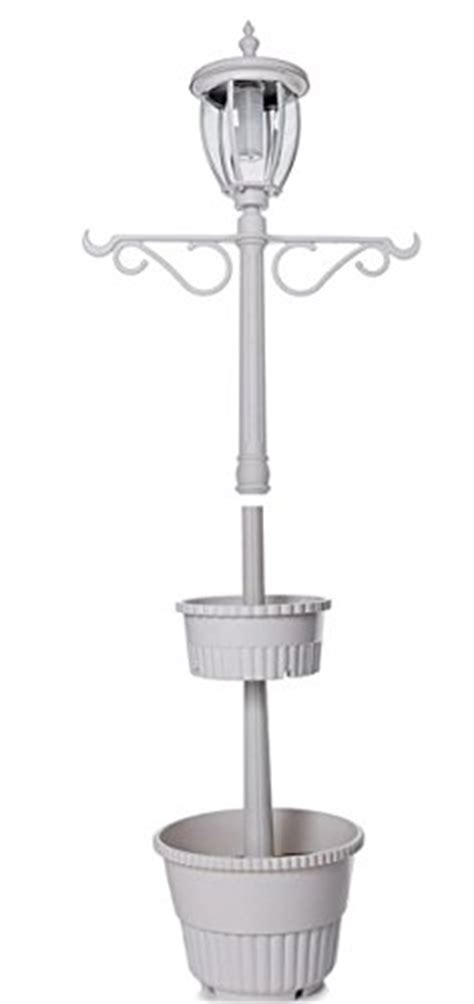 solar l post with planter base hgtv home solar powered l post light with built in