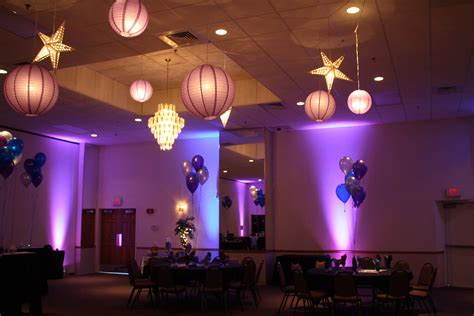 quinceanera star themes moon and stars over the dance floor in blue and purple was