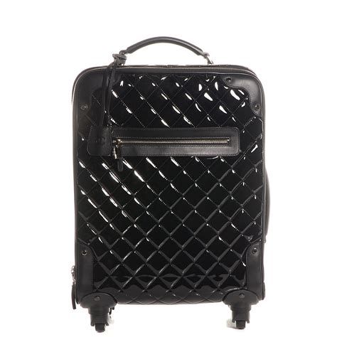 Quilted Rolling Luggage chanel vinyl calfskin quilted trolley rolling luggage black 82321