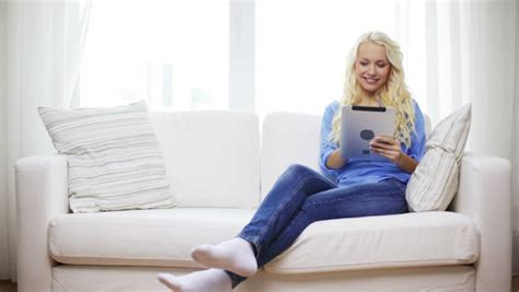 girl on the couch girl sitting on sofa and reading book stock footage video