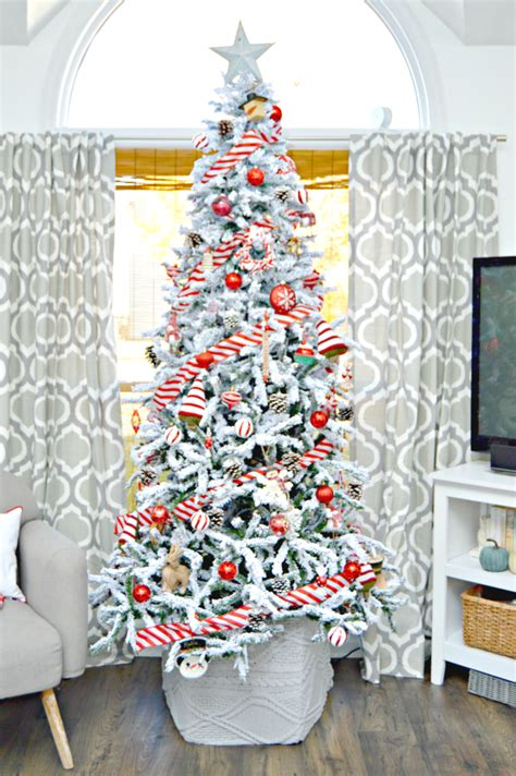 Winter Wonderland Themed Decorating - red and white candy cane themed flocked christmas tree mom 4 real