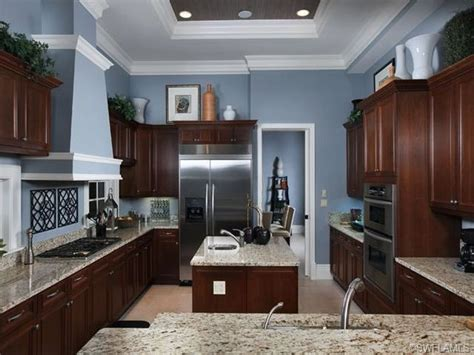 gray paint with cherry cabinets blue gray kitchen with cabinets in grey oaks naples