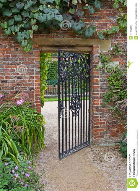 wrought iron garden wall wrought iron gate in garden stock photo image 41979630
