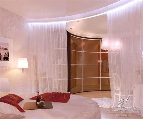 round bedroom cozy bedroom design with curtain round bed red pillows and