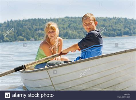 row boat en francais boy and girl in row boat stock photo royalty free image