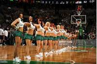 Members Of The Boston Celtics Dance Team Perform For Crowd Against