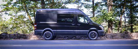 Interior Stuff black dog outside van