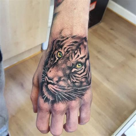 tiger hand tattoo tiger meaning and best designs flowertattooideas