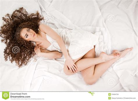 what women like in bed young woman on bed stock photo image of high bedtime