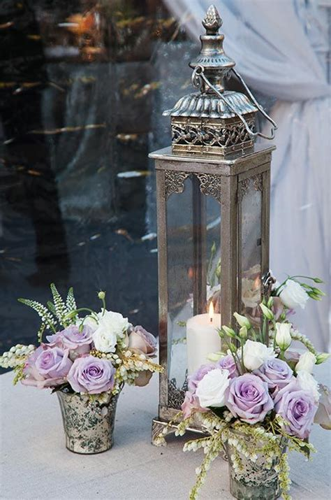 silver lanterns for wedding centerpieces an ornate silver lantern was arranged with mercury vases of lavender and white roses lanterns