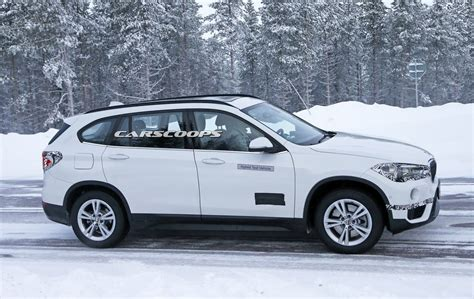 bmw suv hybrid spied bmw plugs a hybrid powertrain into the x1 suv
