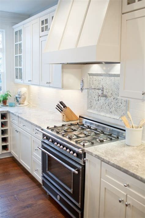 heritage shaker white cabinets white kitchen with vermont white granite white shaker